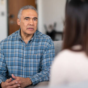An elderly man of African descent talks to a therapist about his marriage. He is serious about working on his relationship with his wife.